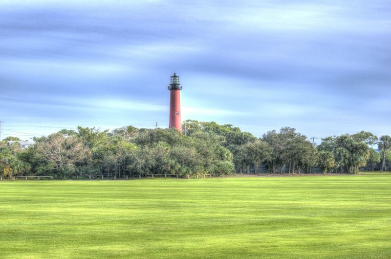 Jupiter Fl Jupiter Florida Jupiter Lighthouse Light House Lighthouse Architecture Beauty In Nature Building Exterior Built Structure Cloud - Sky Day Field Grass Green Color Growth Landscape Lighthouse Lighthouse_lovers Nature No People Outdoors Scenics Sky Tranquility Tree