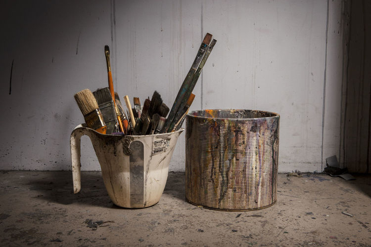 Paintbrush in stained container