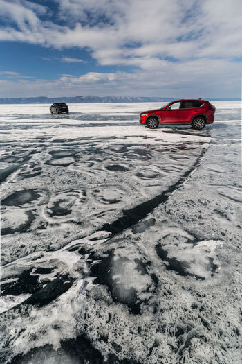 Car on land against sky during winter