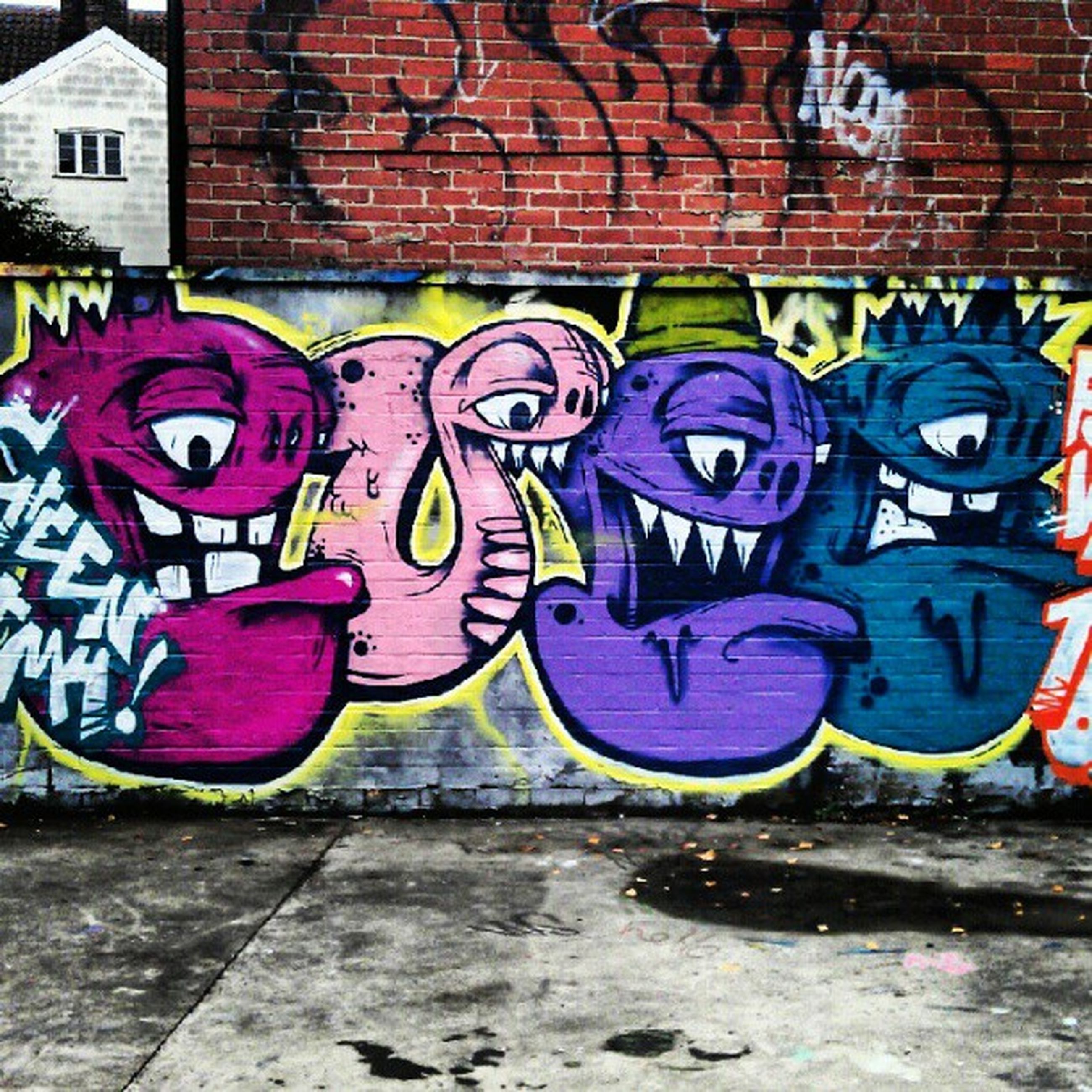 graffiti, multi colored, art and craft, art, creativity, built structure, architecture, building exterior, wall - building feature, street art, colorful, street, outdoors, mural, day, vandalism, human representation, no people, animal representation, wall