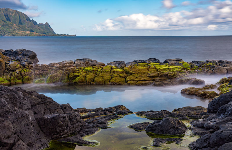 Long exposure of the calm waters of queen's bath, a rock pool off princeville on north of kauai