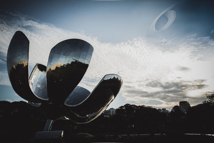the death star in Buenos Aires Buenos Aires Star Wars The Creative - 2018 EyeEm Awards Buenosaires Circle Cloud - Sky Deathstar Digital Composite Flower Geometric Shape Low Angle View Metallic Mirror Nature No People Outdoors Reflection Shape Sky Sky_collection Skyporn Star - Space Technology