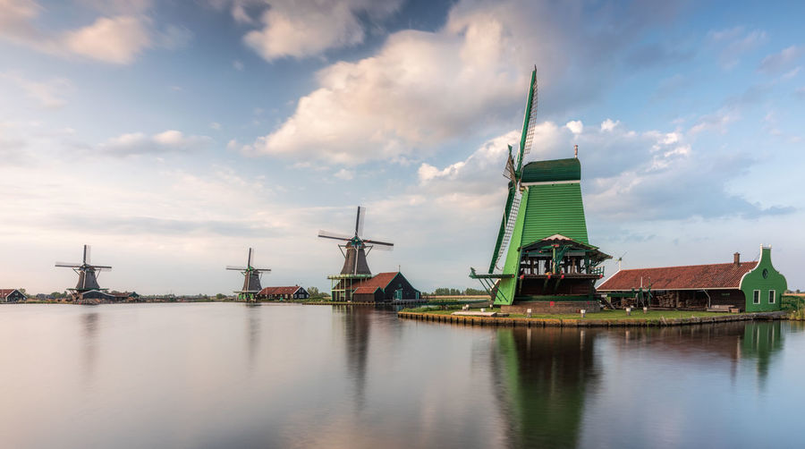 The windmills from The Zaanse Schans on a sunny cloudy day Cloud - Sky Water Sky Waterfront Architecture Traditional Windmill Nature No People Day Outdoors Landscape Dutch Landscape Zaanse Schans Holland Dutch Nederland Netherlands Tourist Attraction  Tourist Destination Long Exposure