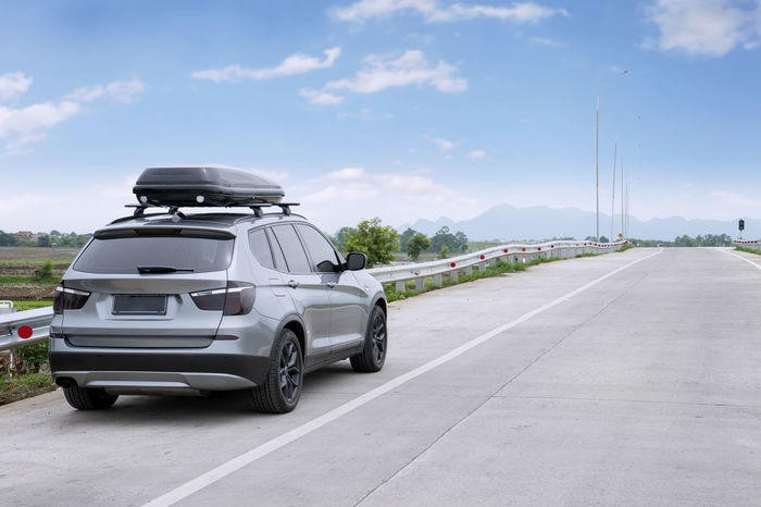 Road trip with BMW X3 Architecture Blue Bmw Bmw X3 Building Exterior Built Structure Car Cloud Cloud - Sky Day Land Vehicle Mode Of Transport Outdoors Parking Road Road Marking Roof Box Roof Rack Sky Street Sunlight The Way Forward Transportation Travel