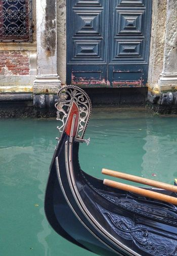 Cropped image of gondola sailing on grand canal against old building