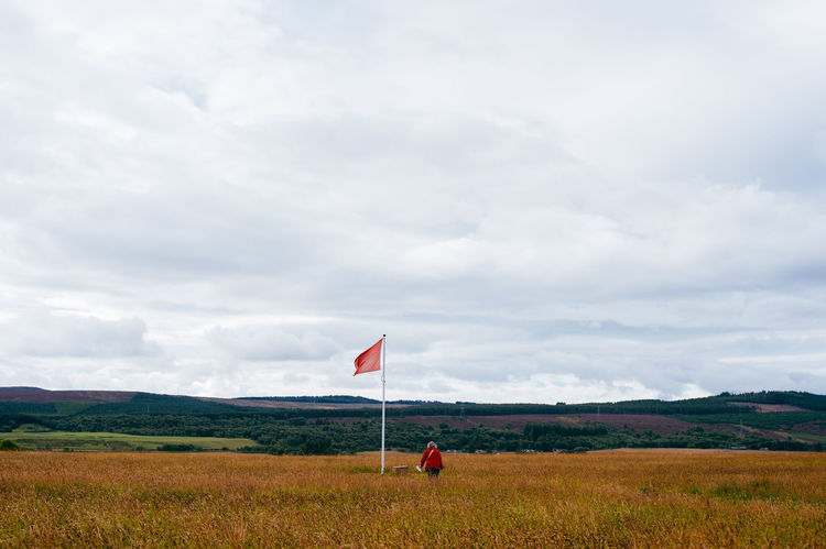Beauty In Nature Cloud - Sky Day Field Flag Grass Landscape Nature No People Outdoors Red Scenics Sky