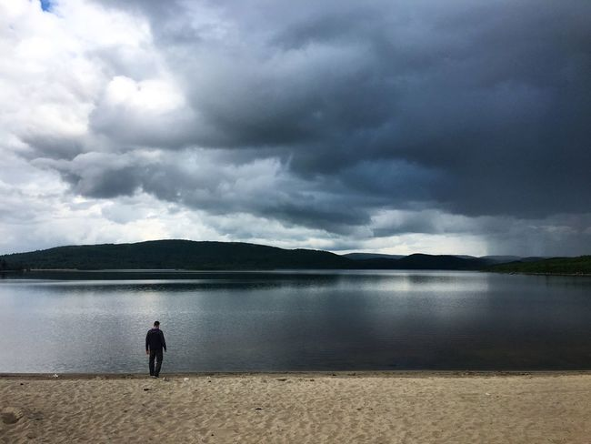 Sky Water Full Length One Person Rear View Cloud - Sky Nature Beauty In Nature Lake Mountain Tranquil Scene Scenics Tranquility Standing Real People Landscape Outdoors Day Men One Man Only