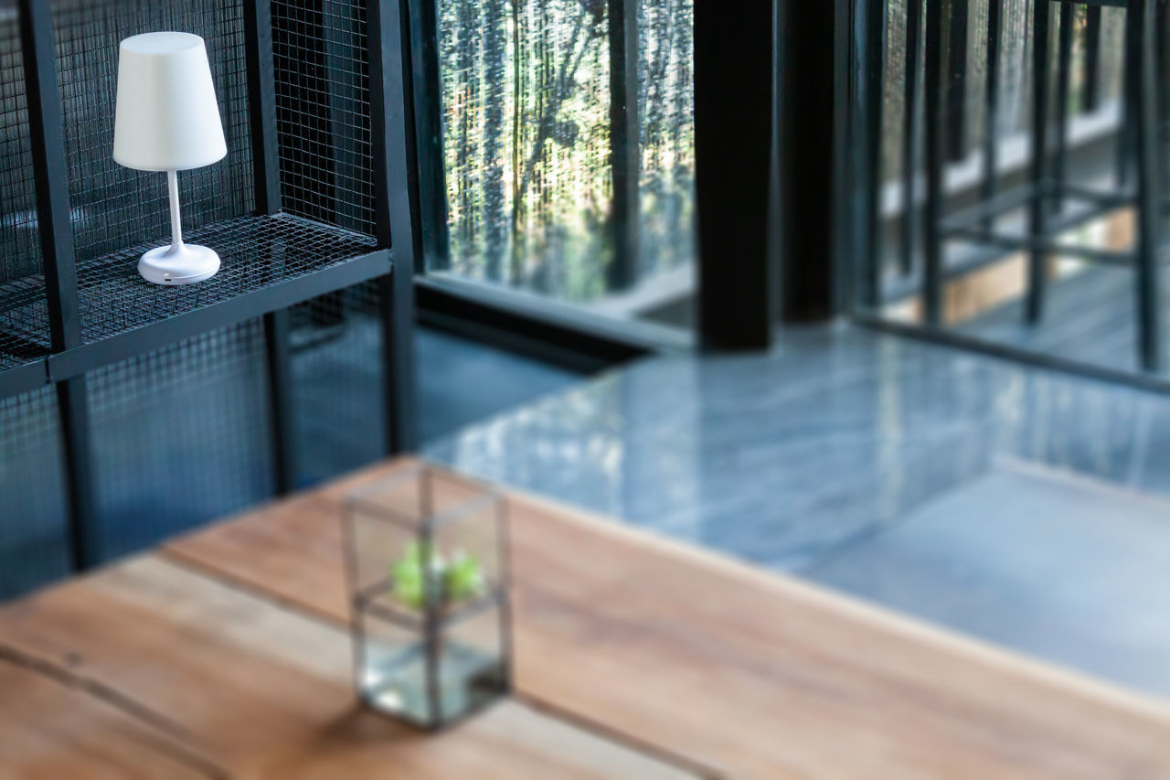 CLOSE-UP OF GLASS WINDOW ON TABLE