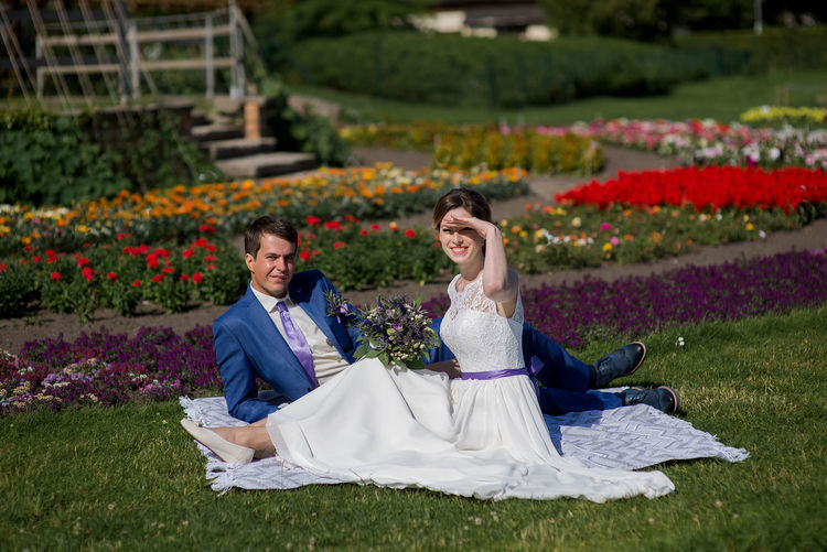 Bride Bridegroom Celebration Cheerful Couple - Relationship Day Flower Full Length Happiness Life Events Lifestyles Love Men Nature Outdoors Real People Sitting Smiling Togetherness Two People Wedding Wedding Dress Women Young Adult Young Women