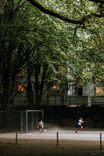 People playing soccer in park