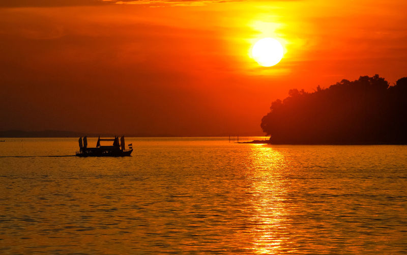Sunset Orange Color Silhouette Landscape Tourism Vacations Travel Sailing Travel Destinations Gold Colored Beauty In Nature Sea Eyeem Select Ship Tropical Climate PenyengatIsland Boats⛵️ Decorative Ship Stockphoto Penyengat Island Sailing Ship EyeEm Selects Sea Life EyeEm Best Edits Sailing Boat