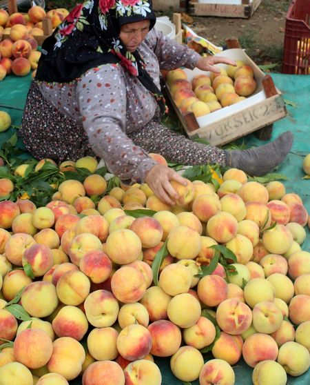 Woman selling peach at market