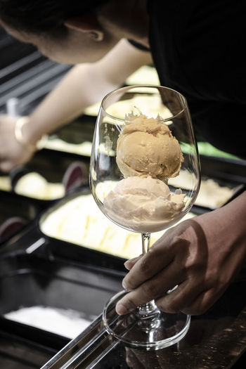 Midsection of man holding ice cream