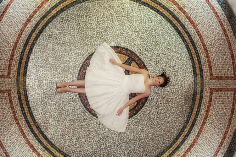 high angle view of woman sleeping on floor Beautiful Woman Circle Clothing Directly Above Full Length Geometric Shape Hairstyle High Angle View Leisure Activity Lifestyles Lying Down One Person Real People Relaxation Resting White Color Women Young Adult Young Women