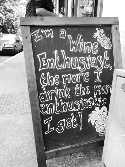 Wisdom. Blackandwhite Blackboard  Close-up Communication Day Enthusiasm Information Information Sign No People Outdoors Street Streetphotography Text Wine