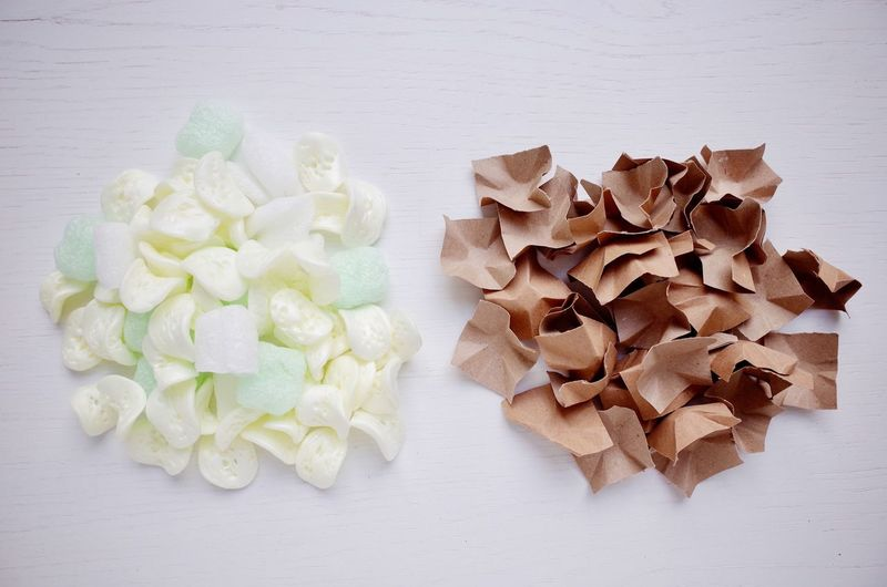 Paper clips and polystyrene chips for cushioning and wrapping material No People Close-up Cardboard Paper Brown Brown Paper Chips Polystyrene Organic Alternative Biodegradable