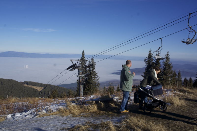 Man And Woman With Baby Carriage On Mountain