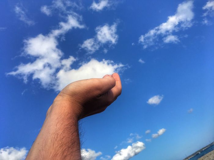 Human Hand Sky Cloud - Sky Human Body Part Blue Human Finger Low Angle View Outdoors Day Nature One Person Real People Leisure Activity Beauty In Nature Lifestyles Men Blue Sky Close-up People Nofilter Let's Go. Together. Let's Go. Together. Sommergefühle Sommergefühle Mix Yourself A Good Time
