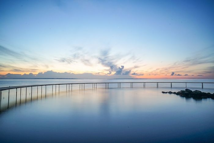 The Infinity Bridge in Aarhus Aarhus Denmark Visitdenmark Sunrise_sunsets_aroundworld Sunrise_Collection Blue Sky Water Cloud - Sky Sea Outdoors Nature No People Beauty The Great Outdoors - 2017 EyeEm Awards Long Exposure Sonyimages📷 Tranquility Sonyphotography Sonya7