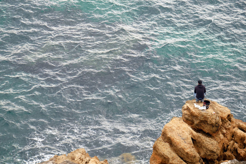 Fisherman Alone Atlantic Ocean Cascais Fishing Rod Fresh Air Loner Man Portugal Waiting Wave Beauty In Nature Breeze Fisherman Fishing Guy Hobby Man Fishing Nature Outdoors Perching Rocks Sea Sea Life Water Waves EyeEmNewHere Step It Up