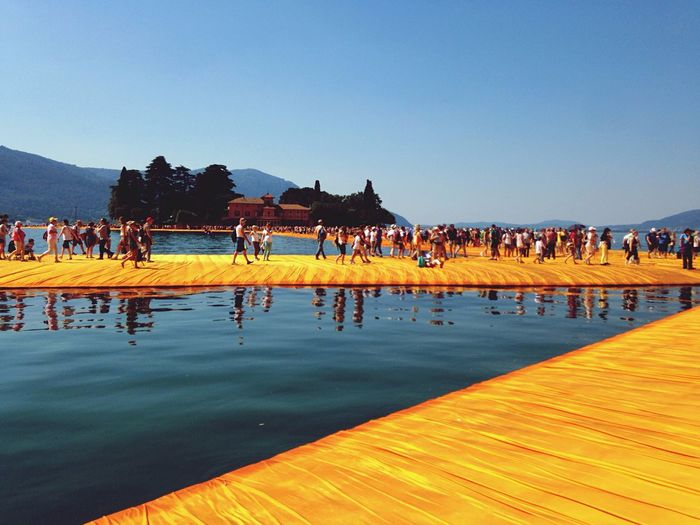 Original Experiences Sure a great one to Walk Barefoot at The Floating Piers By Christo on Monte Isola Lake 's Waters 🇮🇹 Sofiavicchi Sofiavicchiconceptdesign Piers The Floating Piers Art Contemporary Art Bridge - Man Made Structure Creativity Water Crowd