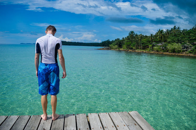 Koh Kood Thailand Blue Cloud - Sky Day Jetty Leisure Activity Lifestyles Nature One Person Pier Real People Rear View Scenics Sky Standing Tree Tropical Turquoise Water Wood - Material Be. Ready.
