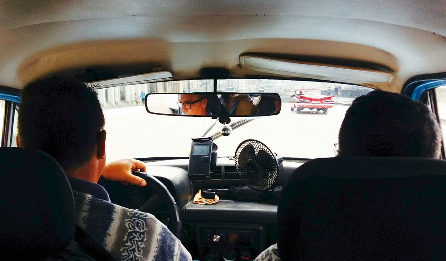 Transportation Mode Of Transportation Car Vehicle Interior Real People Land Vehicle Motor Vehicle Rear View Travel Windshield Driving Men People Lifestyles Car Interior Glass - Material Day Two People Sitting Road Trip Taxi Taxi Driver