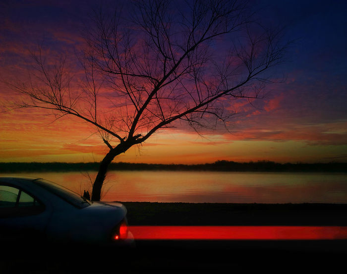 Beauty In Nature Car Car Roof Cloud - Sky Dramatic Sky Horizon Over Water Land Vehicle Mode Of Transport Nature No People Outdoors Reflection Scenics Sea Silhouette Sky Sunset Transportation Tree Water