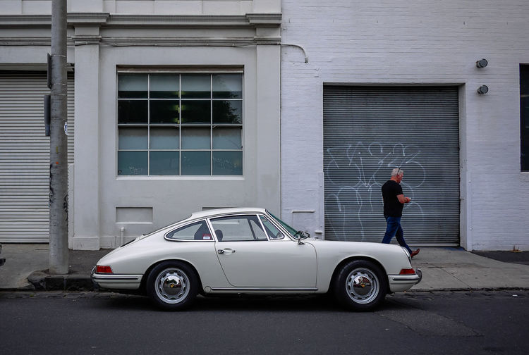 Porche 912 at Brunswick Street 912 Melbourne, Australia Porche Wheel Architecture Brunswick Building Exterior Built Structure Car Day Full Length Land Vehicle Melbourne Men Mode Of Transport Old Car One Person Outdoors People Real People Standing Streetphotography Transportation White The Street Photographer - 2018 EyeEm Awards