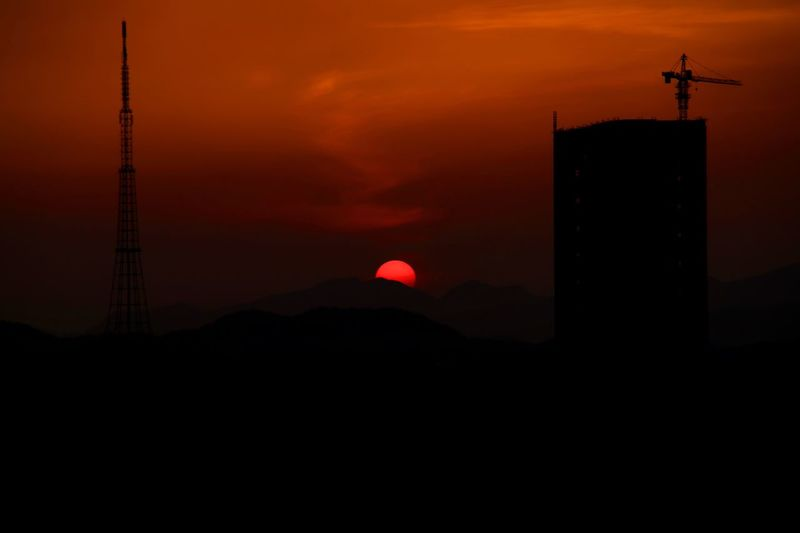Silhouette Tower Against Orange Sky During Sunset