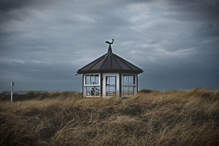 Lifeguard Hut On Landscape Against Sky
