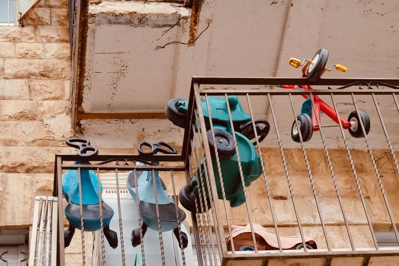 Low angle view of clothes hanging on wall against building