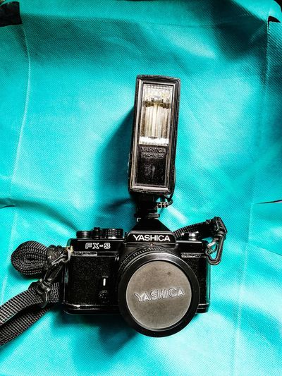 VINTAGE FILM CAMERA... YASHICA FX3 CAMERA WITH FLASH UNIT... Yashica FX3 Vintage Film Camera Camera - Photographic Equipment Photography Themes Technology Table No People Indoors  Retro Styled Old-fashioned Close-up Day Camera