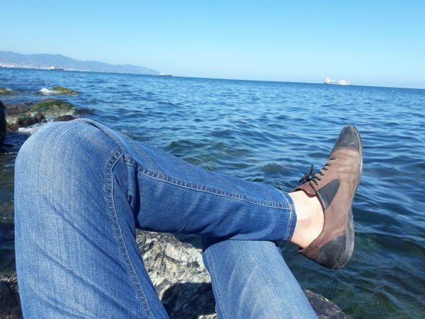 One Person Fashion Sea Relaxation Human Leg Women Day Adult Shoe Human Body Part Leisure Activity Outdoors Lying Down Low Section Only Women Water Lifestyles Beach Horizon Over Water One Woman Only Young Women Cloud - Sky Casual Clothing Business Finance And Industry Business