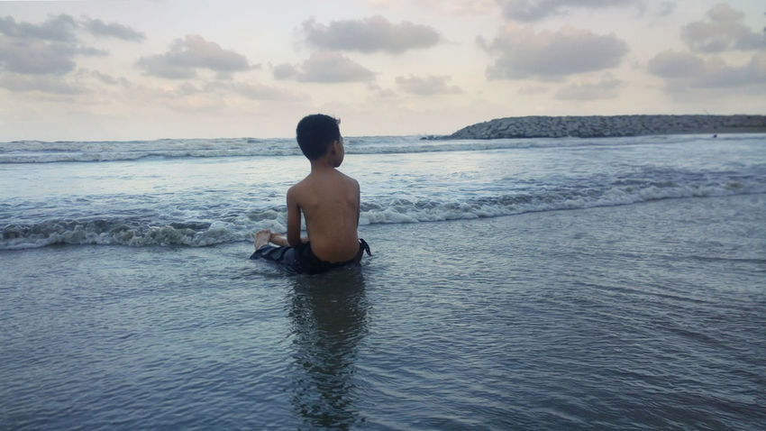 picture of kid play with wave at beach Travel Travel Photography Holiday Vacations Vacation Time Eyemphotography EyeEmNewHere Eyem Gallery Play Kid Back Human Back Water Sea Beauty Beach Summer Shirtless Portrait Muscular Build Wave Shore Coast Horizon Over Water Seascape Groyne