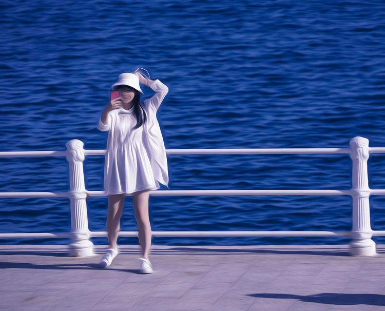 Adult Cruise Ship Day Deck Full Length Leisure Activity Lifestyles Mode Of Transportation Nature Nautical Vessel One Person Outdoors Railing Real People Sea Standing Water Women