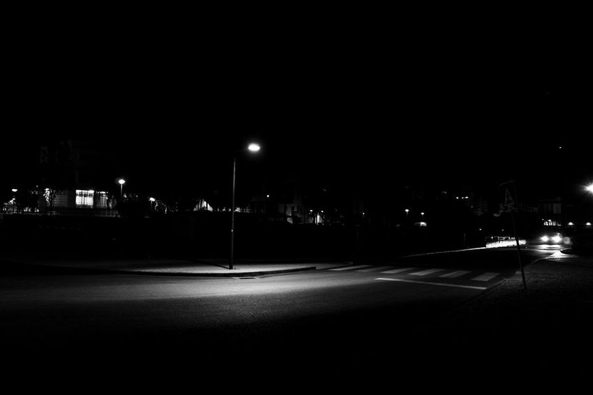 Architecture Blackandwhite Building Exterior Built Structure City City Life Copy Space Dark Direction Empty Illuminated Lighting Equipment Night No People Outdoors Road Sign Sky Street Street Light Symbol Transportation HUAWEI Photo Award: After Dark