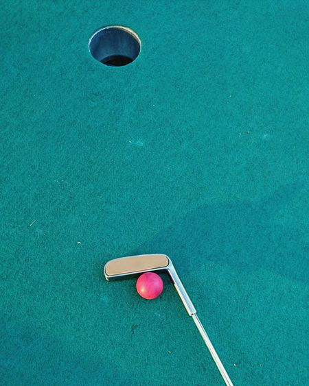 Golf Club And Ball By Hole