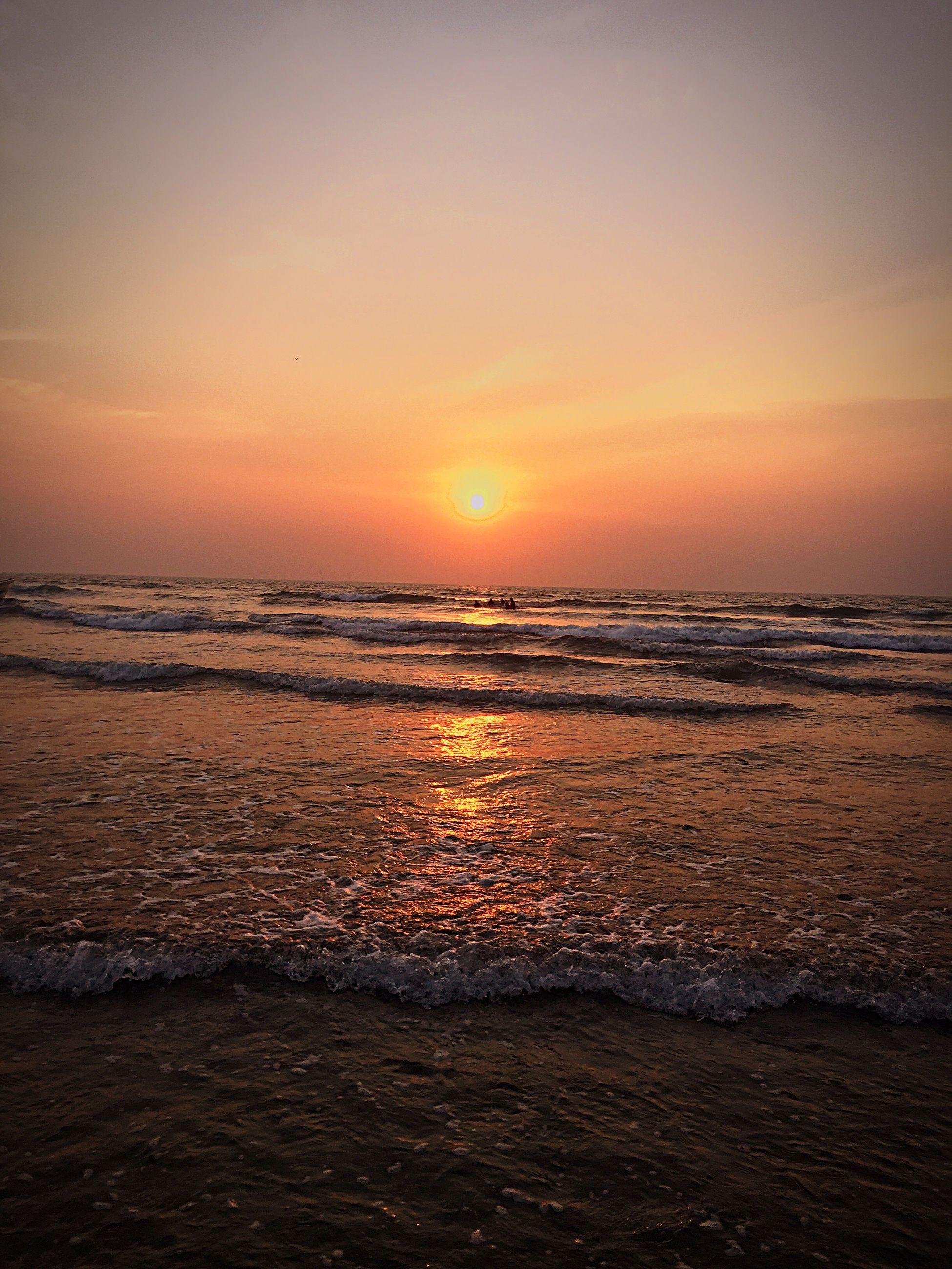 sea, sunset, horizon over water, water, scenics, tranquil scene, beach, beauty in nature, orange color, tranquility, shore, sky, idyllic, nature, wave, sun, seascape, rippled, coastline, remote