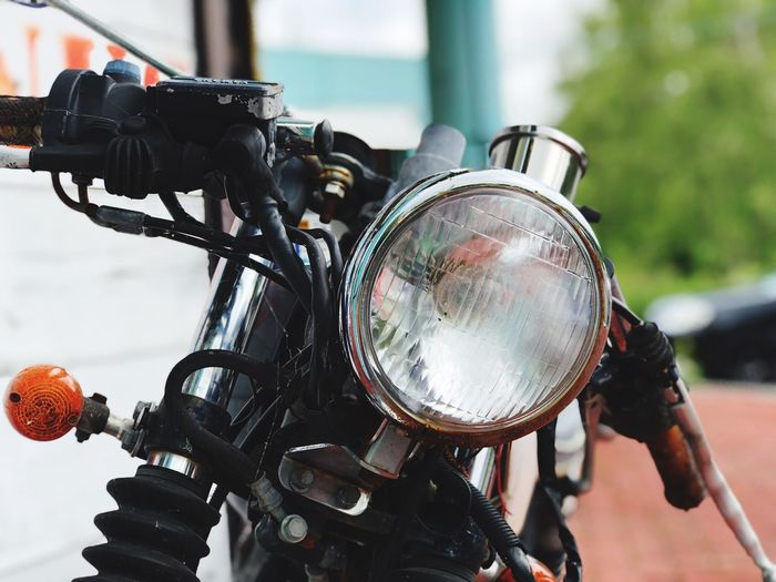 Close-up of motorcycle headlight