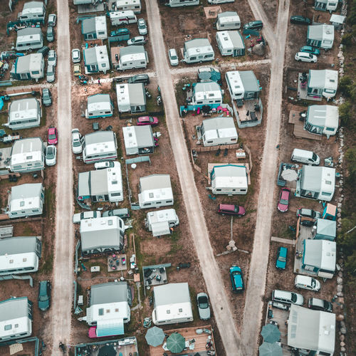 Aerial View Of Caravans And Cars Parked On Road