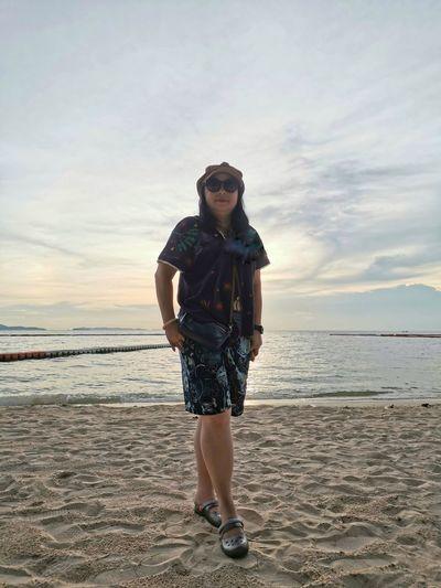 Full length portrait of man standing on beach