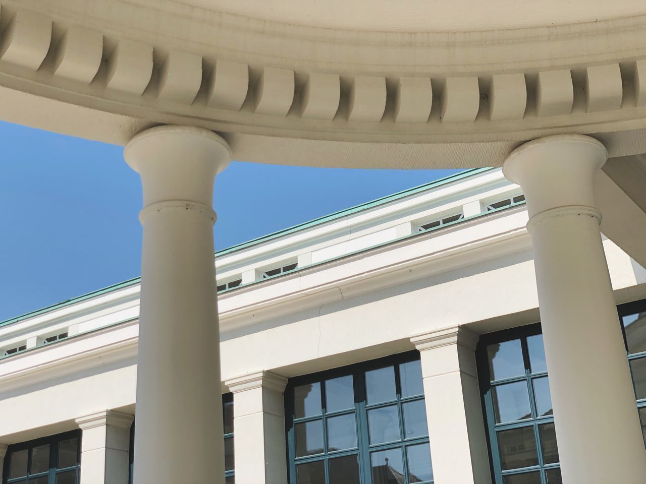 architecture, built structure, low angle view, building exterior, architectural column, no people, building, day, sunlight, sky, travel, clear sky, outdoors, nature, travel destinations, tourism, window, blue, pattern, architectural feature, ceiling, neo-classical, colonnade