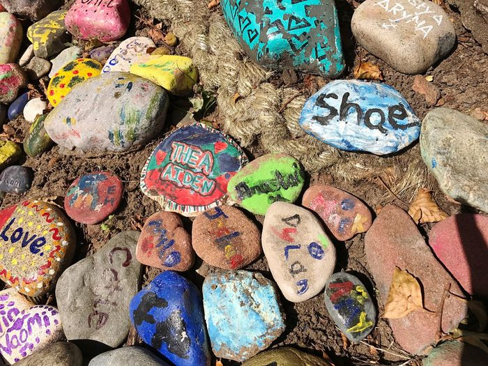 Decorative pebbles in Vale Park, New Brighton, Multi Colored The Week On EyeEm Outdoors Pebbles And Stones Pebbles Painted Pebble Names On Pebbles Names Painted Names ArtWork Sculpture Garden Sculpture No People Large Group Of Objects Day Close-up Artworks The Week On EyeEm