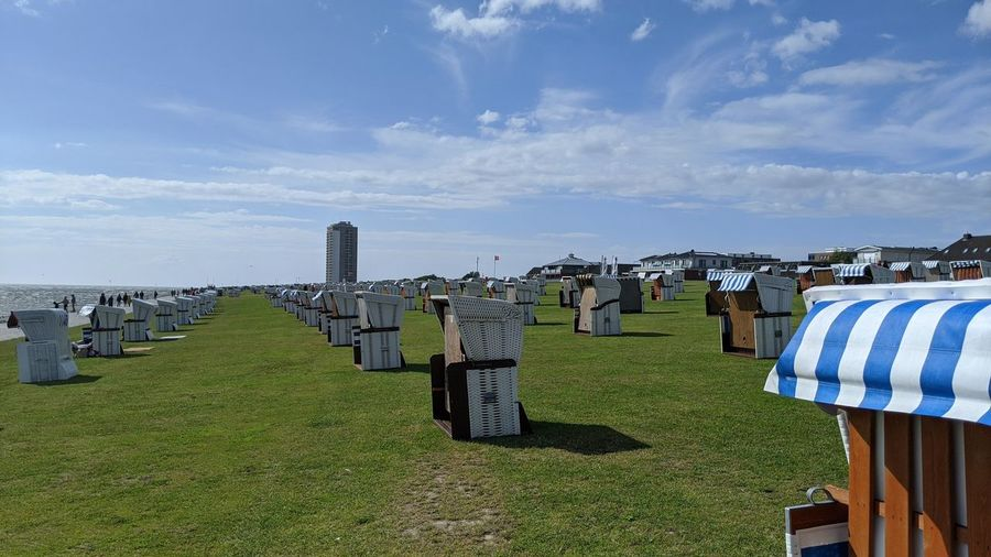 Row of cemetery against sky