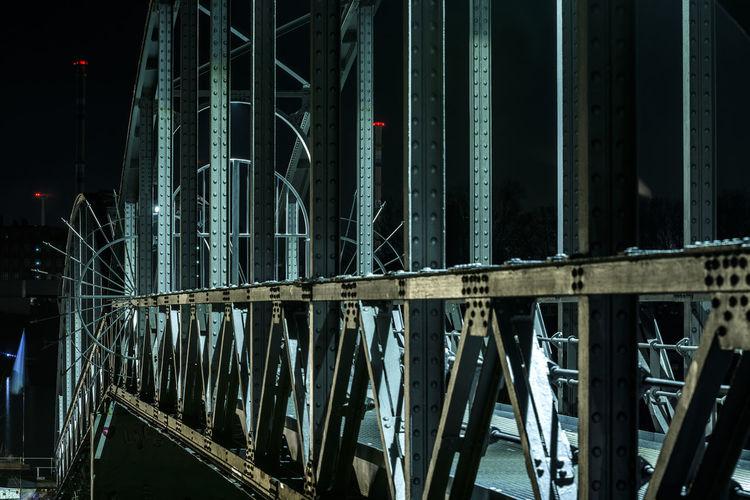 Illuminated Metallic Bridge At Night