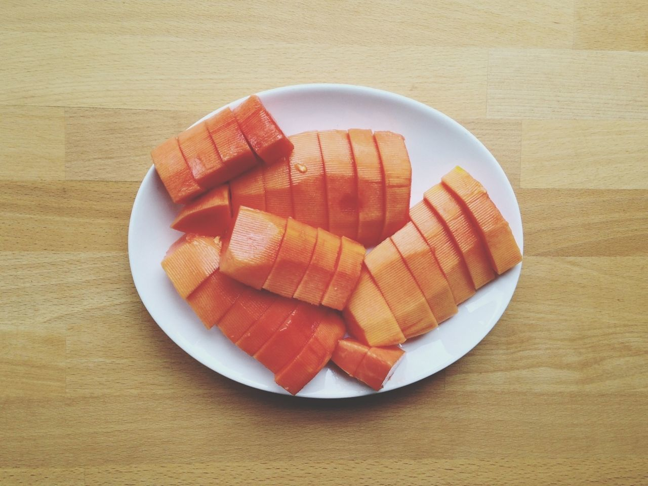 High angle view of papaya slices in plate on table
