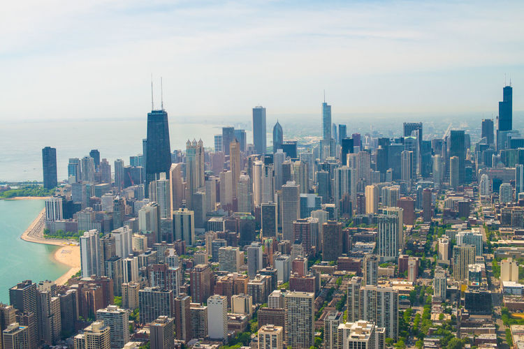 Aerial view of chicago against cloudy sky