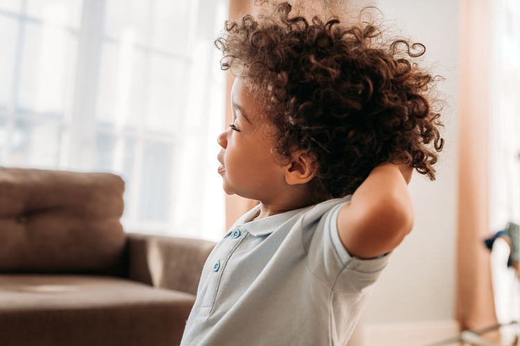 Portrait of boy looking at home