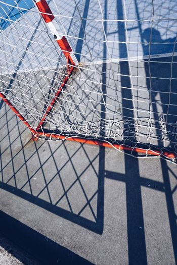 soccer goal sport and rope net in the field in the street Sport Soccer Goal Net Web Rope Field Street Streetphotography Outdoors Sport Equipment Minimalism Old Abandoned Broken Red White